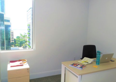Private office with window and ocean view